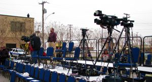Press riser at political event